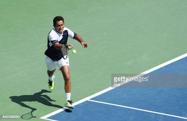 Nicolas Almagro of Spain returns a shot during his first round Men's Singles match against Steve Johnson of the United States on Day One of the 2017...