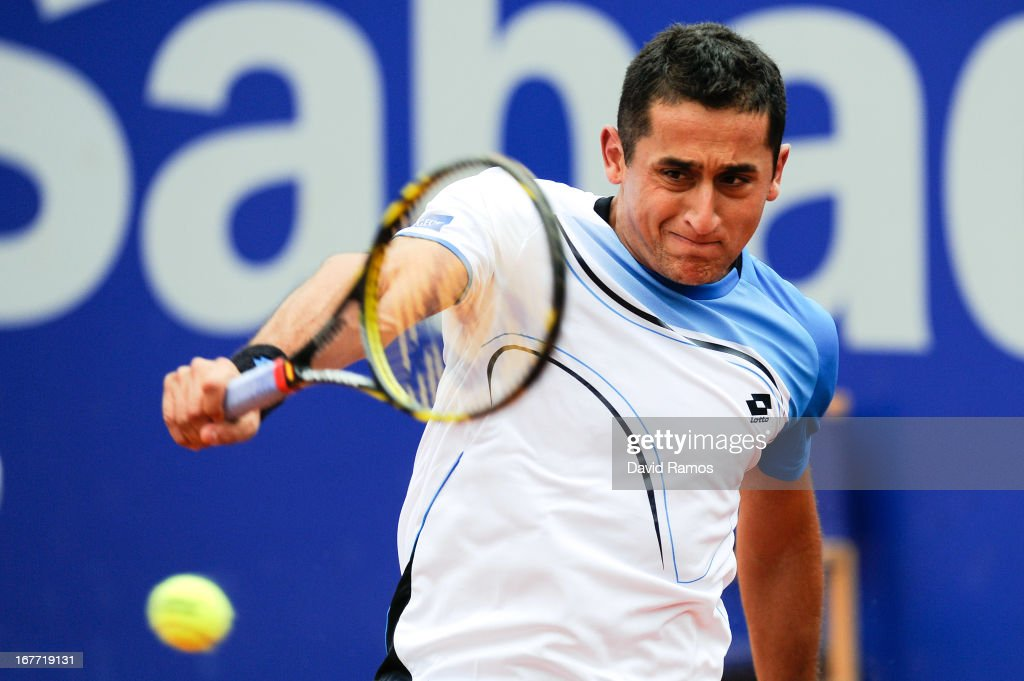 Nicolas Almagro of Spain returns the ball againts Rafael Nadal of Spain during his final match of day seven of the 2013 Barcelona Open Banc Sabadell on April 28, 2013 in Barcelona. Nadal won 6-3, 6-4.