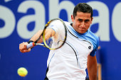 Nicolas Almagro of Spain returns the ball againts Rafael Nadal of Spain during his final match of day seven of the 2013 Barcelona Open Banc Sabadell...