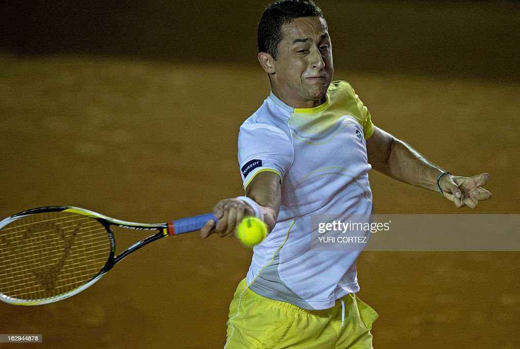 Nicolas Almagro of Spain returns the ball to his compatriot Rafael Nadal during their semi-final Mexico ATP Open men's single tennis match, in Acapulco, Guerrero state on March 1, 2013. AFP PHOTO/ Yuri CORTEZ