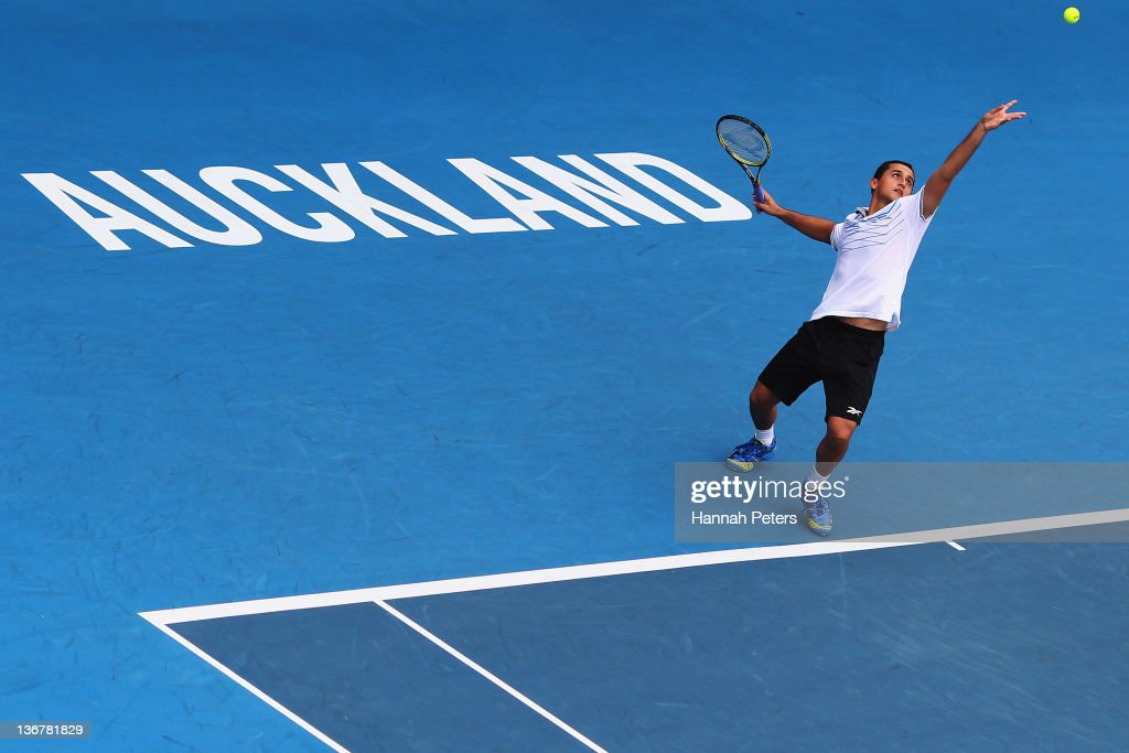 Nicolas Almagro of Spain serves against Philipp Kohlschreiber of Germany during day four of the 2012 Heineken Open at ASB Tennis Centre on January 12...