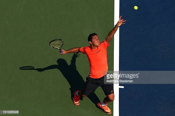 Nicolas Almagro of Spain serves during his men's singles second round match against Philipp Petzschner of Germany on Day Four of the 2012 US Open at...
