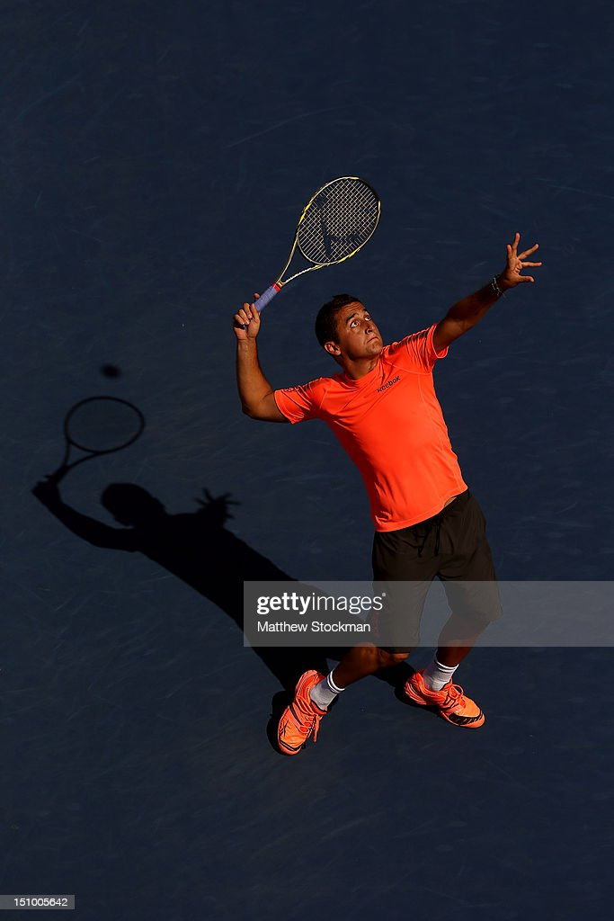 <a gi-track='captionPersonalityLinkClicked' href=/galleries/search?phrase=Nicolas+Almagro&family=editorial&specificpeople=553850 ng-click='$event.stopPropagation()'>Nicolas Almagro</a> of Spain serves during his men's singles second round match against Philipp Petzschner of Germany on Day Four of the 2012 US Open at USTA Billie Jean King National Tennis Center on August 30, 2012 in the Flushing neigborhood of the Queens borough of New York City.