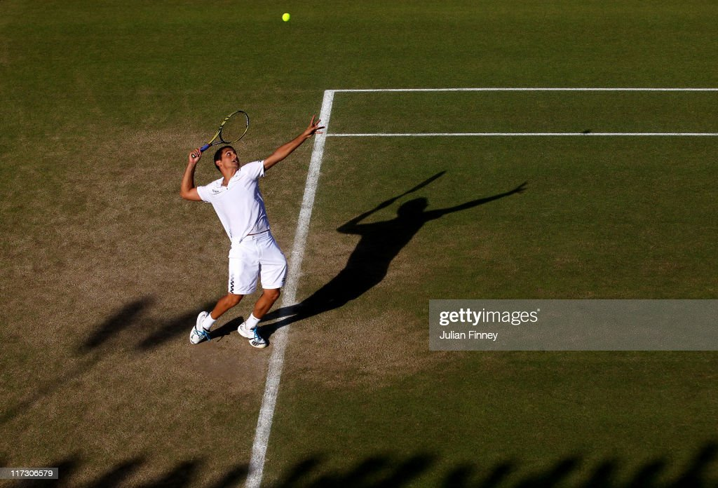 <a gi-track='captionPersonalityLinkClicked' href=/galleries/search?phrase=Nicolas+Almagro&family=editorial&specificpeople=553850 ng-click='$event.stopPropagation()'>Nicolas Almagro</a> of Spain serves during his third round match against Mikhail Youzhny of Russia on Day Six of the Wimbledon Lawn Tennis Championships at the All England Lawn Tennis and Croquet Club on June 25, 2011 in London, England.