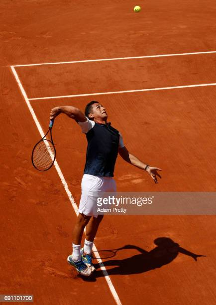 Nicolas Almagro of Spain serves during the men's singles second round match against Juan Martin Del Potro of Argentina on day five of the 2017 French...