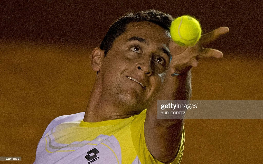 Nicolas Almagro of Spain serves the ball to his compatriot Rafael Nadal during their semi-final Mexico ATP Open men's single tennis match, in Acapulco, Guerrero state on March 1, 2013. AFP PHOTO/ Yuri CORTEZ
