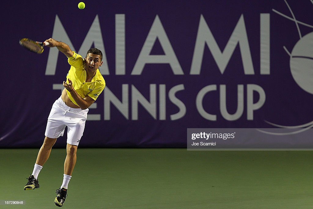 Nicolas Almagro of Spain serves to John Isner of USA during the inaugural Miami Tennis Cup at Crandon Park Tennis Center on December 1 2012 in Key...