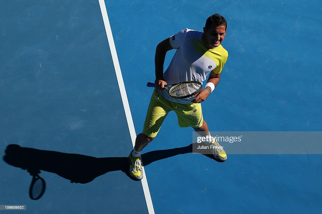 Nicolas Almagro of Spain stretches his leg in his Quarterfinal match against David Ferrer of Spain during day nine of the 2013 Australian Open at Melbourne Park on January 22, 2013 in Melbourne, Australia.