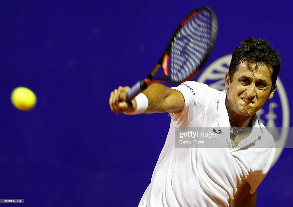 Almagro Spain  city photos : Nicolas Almagro of Spain takes a backhand shot during a match between ...