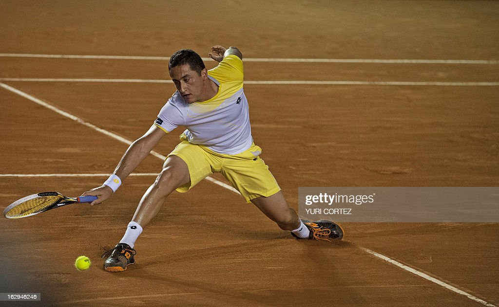 Nicolas Almagro of Spain tries to save the ball during their semi-final Mexico ATP Open men's single tennis match against his compatriot Rafael Nadal, in Acapulco, Guerrero state on March 1, 2013. AFP PHOTO/ Yuri CORTEZ