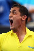 Nicolas Almagro of Spain yells in his third round match against Stanislas Wawrinka of Switzerland during day five of the 2012 Australian Open at...