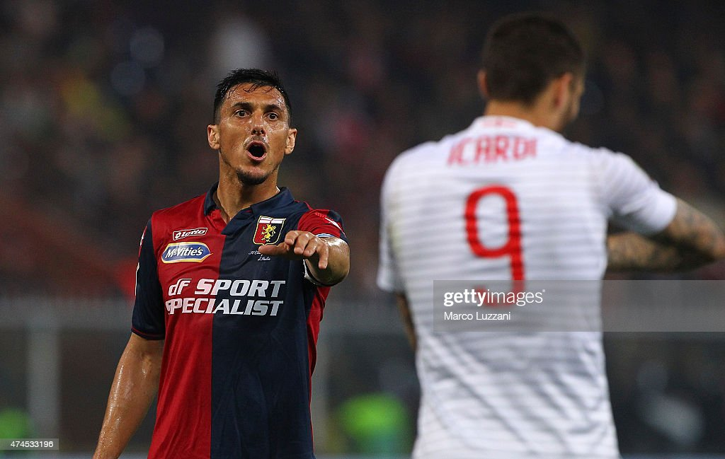 Nicolas Andres Burdisso of Genoa CFC speaks to Mauro Emanuel Icardi of FC Internazionale Milano during the Serie A match between Genoa CFC and FC...