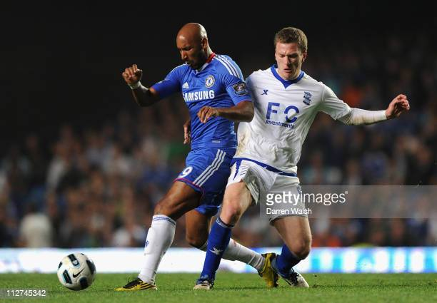 Nicolas Anelka of Chelsea and Craig Gardner of Birmingham City battle for the ball during the Barclays Premier League match between Chelsea and...