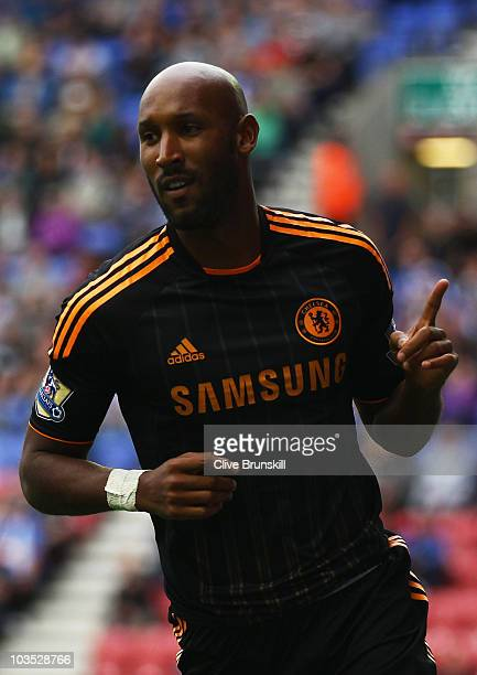 Nicolas Anelka of Chelsea celebrates as he scores their second goal during the Barclays Premier League match between Wigan Athletic and Chelsea at DW...