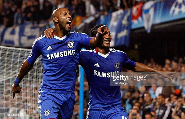 Nicolas Anelka of Chelsea celebrates his goal from the penalty spot with teammate Florent Malouda during the UEFA Champions League Group F match...