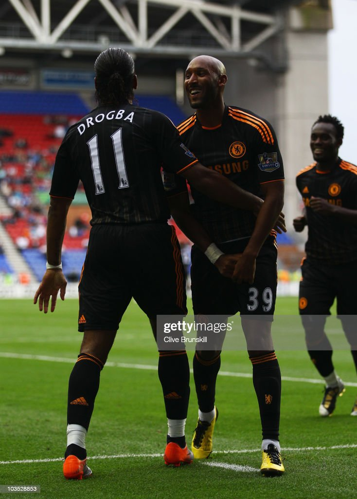 <a gi-track='captionPersonalityLinkClicked' href=/galleries/search?phrase=Nicolas+Anelka&family=editorial&specificpeople=206204 ng-click='$event.stopPropagation()'>Nicolas Anelka</a> of Chelsea celebrates with <a gi-track='captionPersonalityLinkClicked' href=/galleries/search?phrase=Didier+Drogba&family=editorial&specificpeople=179398 ng-click='$event.stopPropagation()'>Didier Drogba</a> (11) as he scores their third goal during the Barclays Premier League match between Wigan Athletic and Chelsea at DW Stadium on August 21, 2010 in Wigan, England.