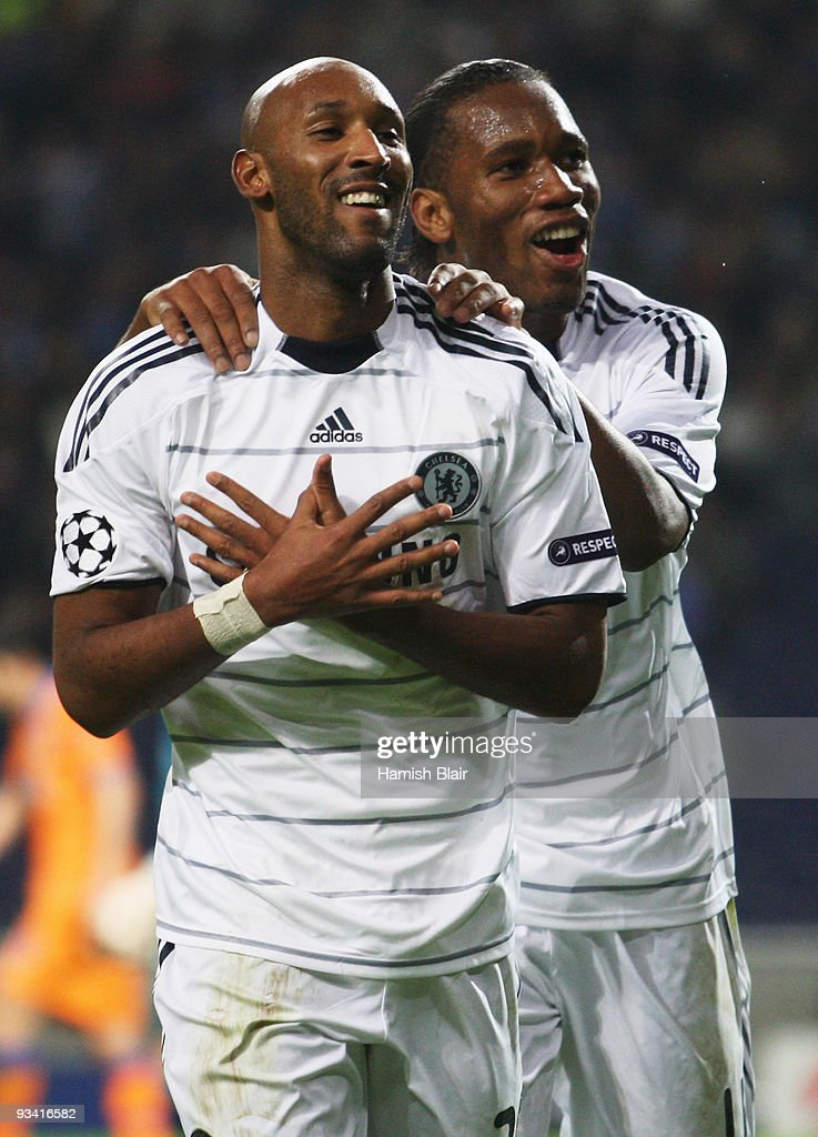 <a gi-track='captionPersonalityLinkClicked' href=/galleries/search?phrase=Nicolas+Anelka&family=editorial&specificpeople=206204 ng-click='$event.stopPropagation()'>Nicolas Anelka</a> of Chelsea (L) celebrates with <a gi-track='captionPersonalityLinkClicked' href=/galleries/search?phrase=Didier+Drogba&family=editorial&specificpeople=179398 ng-click='$event.stopPropagation()'>Didier Drogba</a> as he scores their first goal during the UEFA Champions League Group D match between FC Porto and Chelsea at the Estadio Do Dragao on November 25, 2009 in Porto, Portugal.