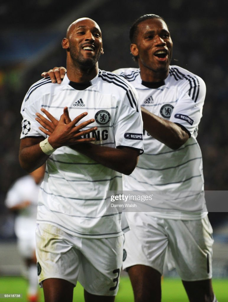 Nicolas Anelka of Chelsea (L) celebrates with Didier Drogba as he scores their first goal during the UEFA Champions League Group D match between FC Porto and Chelsea at the Estadio Do Dragao on November 25, 2009 in Porto, Portugal.