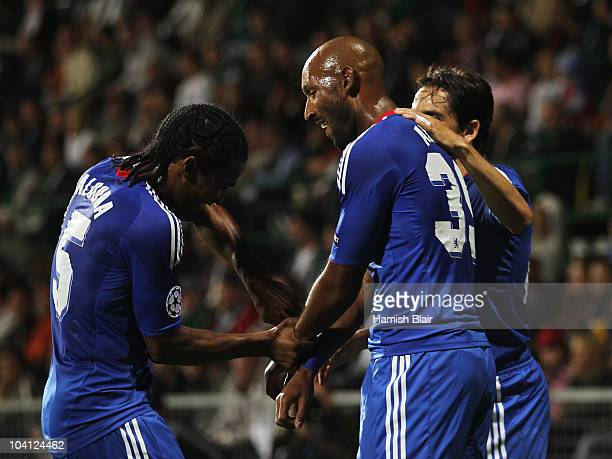 Nicolas Anelka of Chelsea celebrates with Florent Malouda and Yossi Benayoun scores their second goal during the UEFA Champions League Group F match...
