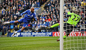 Nicolas Anelka of Chelsea heads the ball past Jussi Jaaskelainen the Bolton Wanderers goalkeeper to score the first goal during the Barclays Premier...