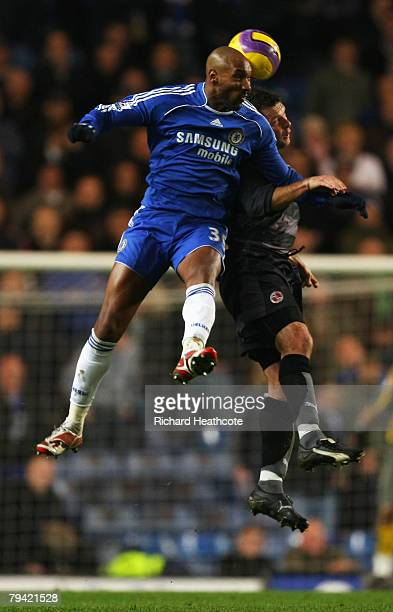 Nicolas Anelka of Chelsea outjumps Graeme Murty of Reading during the Barclays Premier League match between Chelsea and Reading at Stamford Bridge on...