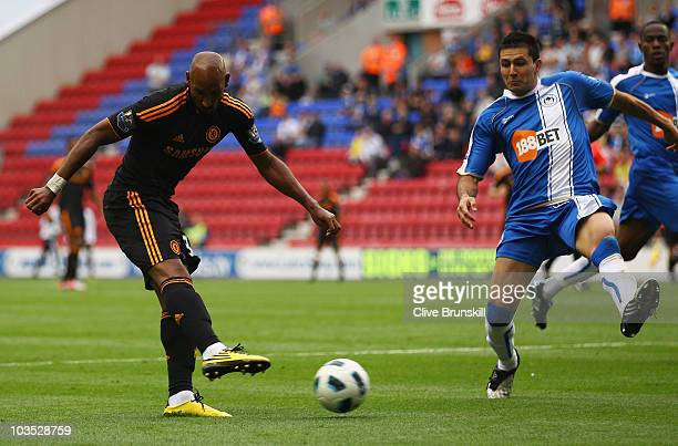 Nicolas Anelka of Chelsea scores their second goal during the Barclays Premier League match between Wigan Athletic and Chelsea at DW Stadium on...