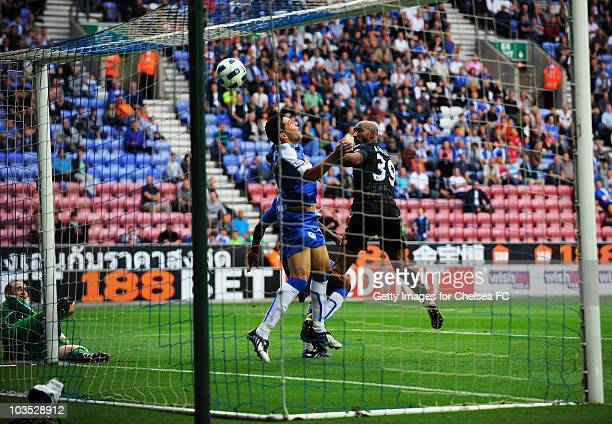 Nicolas Anelka of Chelsea scores their third goal during the Barclays Premier League match between Wigan Athletic and Chelsea at DW Stadium on August...