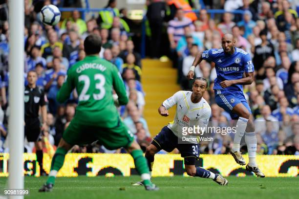 Nicolas Anelka of Chelsea shoots past Benoit AssouEkotto of Spurs at the goalmouth of Carlo Cudicini of Spurs during the Barclays Premier League...