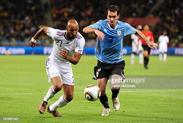 Nicolas Anelka of France and Diego Godin of Uruguay battle for the ball during the 2010 FIFA World Cup South Africa Group A match between Uruguay and...