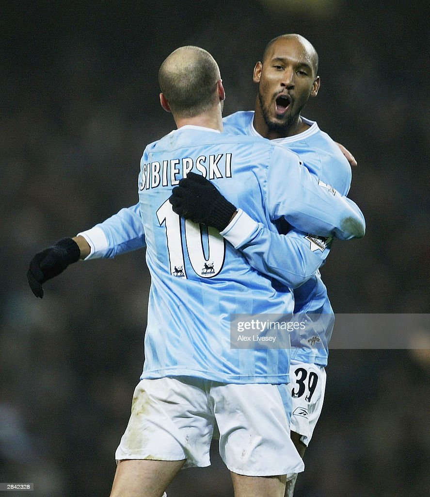 Nicolas Anelka of Manchester City celebrates his second goal with Antoine Sibierski during the FA Cup third round match between Manchester City and Leicester City at City of Manchester Stadium on January 3, 2004 in Manchester, England.