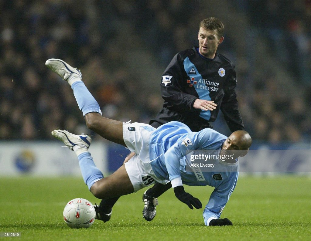 Nicolas Anelka of Manchester City is tackled by Billy McKinlay of Leicester City during the FA Cup third round match between Manchester City and Leicester City at City of Manchester Stadium on January 3, 2004 in Manchester, England.