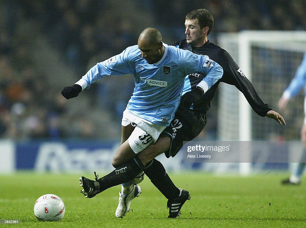 Nicolas Anelka of Manchester City (L) is tackled by Billy McKinlay of Leicester City during the FA Cup third round match between Manchester City and Leicester City at City of Manchester Stadium on January 3, 2004 in Manchester, England.