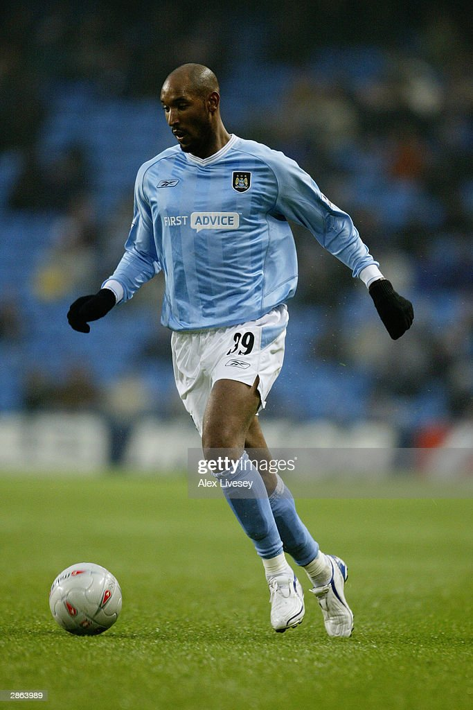 Nicolas Anelka of Manchester City running with the ball during the FA Cup third round match between Manchester City and Leicester City on January 3, 2004 at the City of Manchester Stadium in Manchester, England. The match finished in a 2-2 draw.