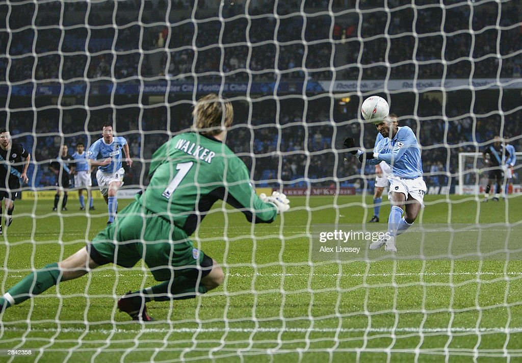 Nicolas Anelka of Manchester City scores from the penalty spot during the FA Cup Third round match between Manchester City and Leicester City at City of Manchester Stadium on January 3, 2004 in Manchester, England.