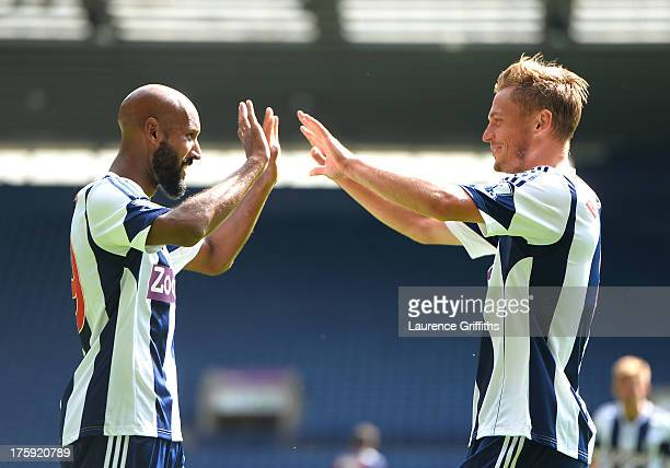 Nicolas Anelka of West Bormwich Albion congratulates Markus Rosenberg on his goal during a Pre Season Friendly between West Bromwich Albion and...