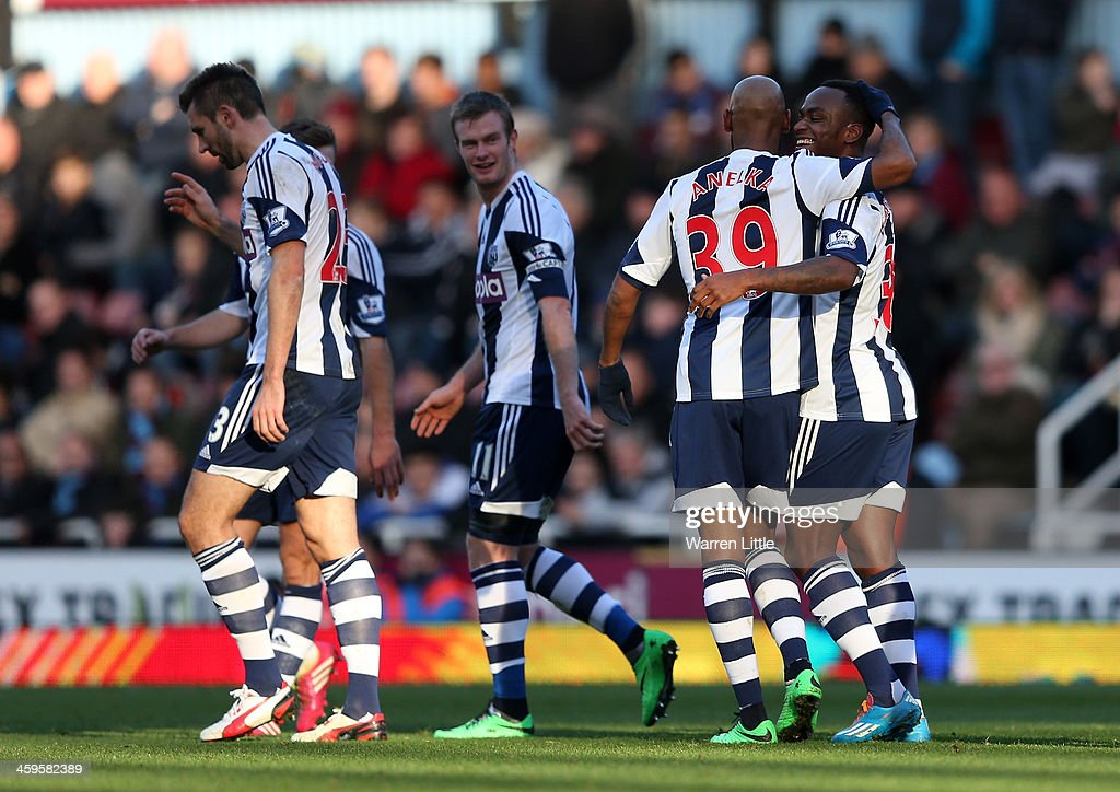 <a gi-track='captionPersonalityLinkClicked' href=/galleries/search?phrase=Nicolas+Anelka&family=editorial&specificpeople=206204 ng-click='$event.stopPropagation()'>Nicolas Anelka</a> of West Brom celebrates scoring their first goal with <a gi-track='captionPersonalityLinkClicked' href=/galleries/search?phrase=Saido+Berahino&family=editorial&specificpeople=6216861 ng-click='$event.stopPropagation()'>Saido Berahino</a> of West Brom during the Barclays Premier League match between West Ham United and West Bromwich Albion at Boleyn Ground on December 28, 2013 in London, England.