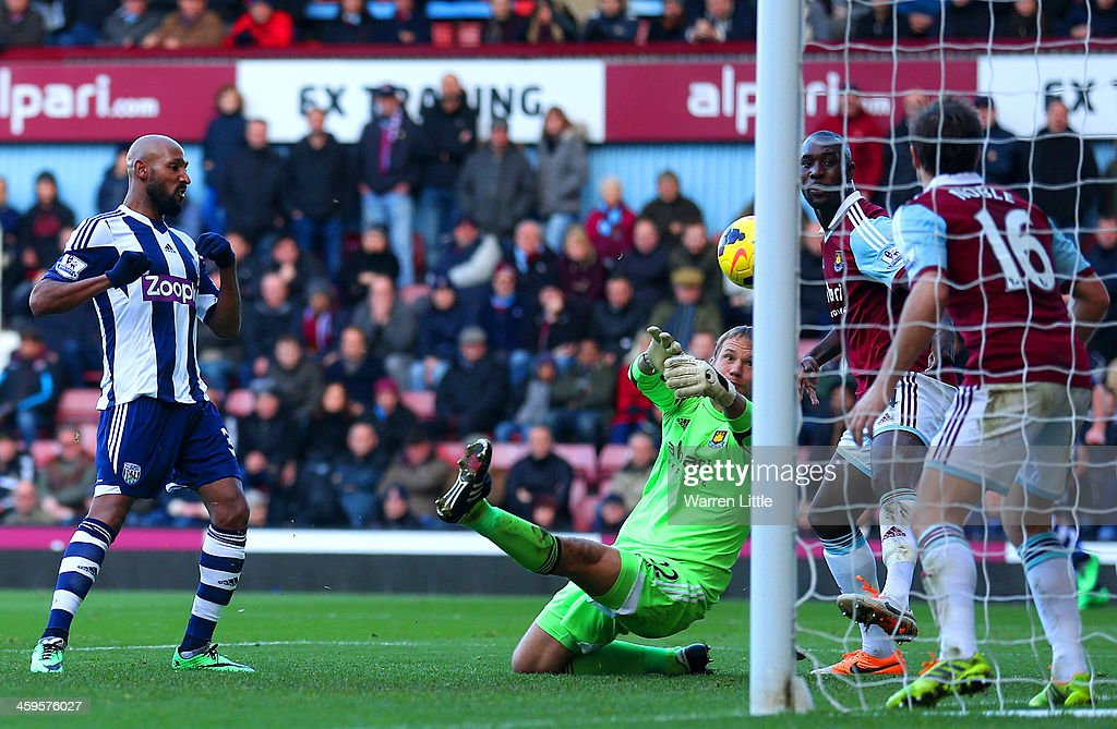Nicolas Anelka of West Brom scores their second goal past Jussi Jaaskelainen of West Ham during the Barclays Premier League match between West Ham United and West Bromwich Albion at Boleyn Ground on December 28, 2013 in London, England.