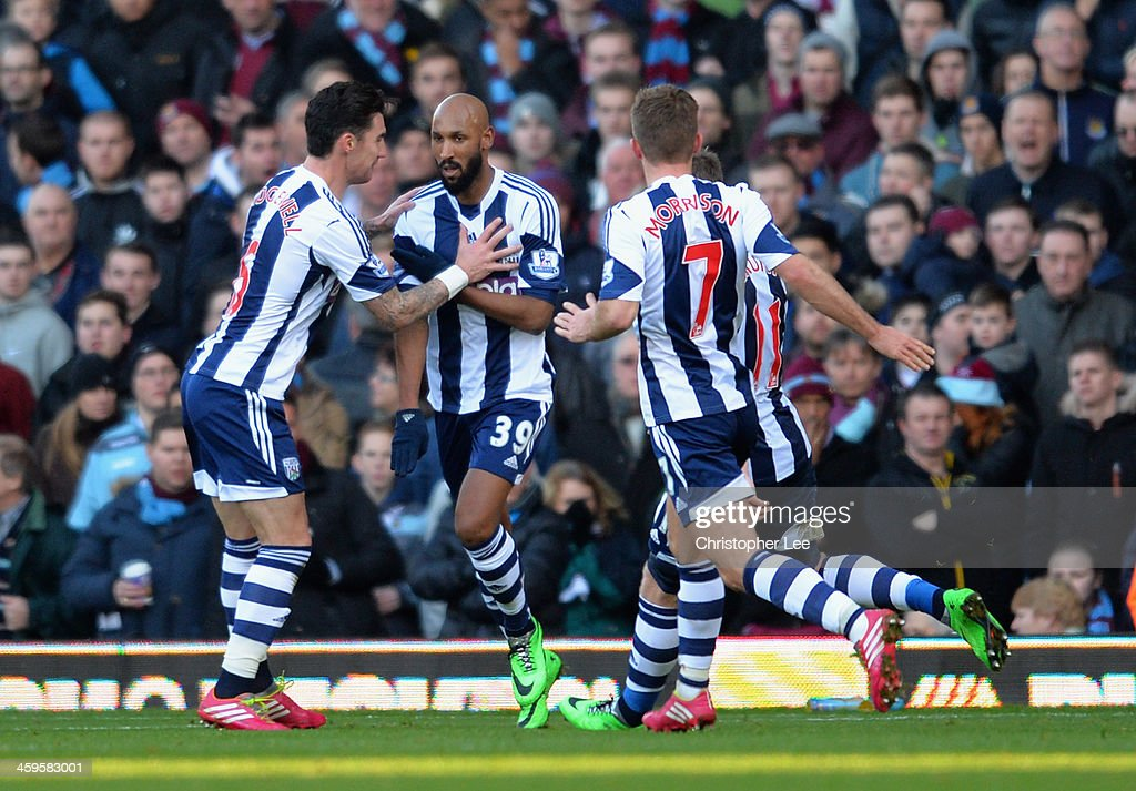 Nicolas Anelka of West Brom touches his sleeve as he celebrates scoring their first goal during the Barclays Premier League match between West Ham United and West Bromwich Albion at Boleyn Ground on December 28, 2013 in London, England.