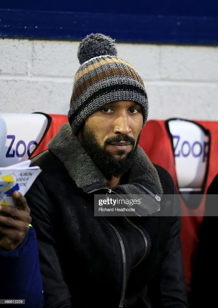<a gi-track='captionPersonalityLinkClicked' href=/galleries/search?phrase=Nicolas+Anelka&family=editorial&specificpeople=206204 ng-click='$event.stopPropagation()'>Nicolas Anelka</a> of West Brom watches from the stand during the Budweiser FA Cup third round match between West Bromwich Albion and Crystal Palace at The Hawthorns on January 4, 2014 in West Bromwich, England.
