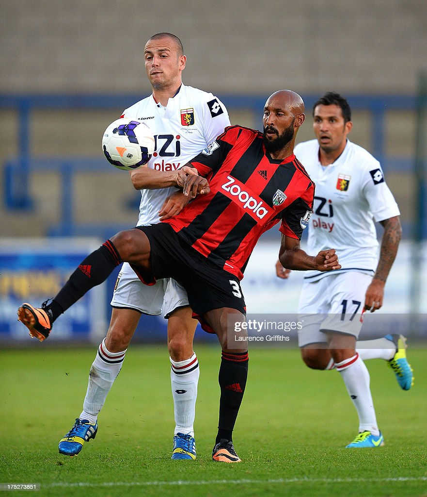 Nicolas Anelka of West Bromwich Albion battles with Antonelli Luca of Genoa during a Pre Season Friendly between West Bromwich Albion and Genoa at the New Bucks Head Stadium on August 1, 2013 in Telford, England.