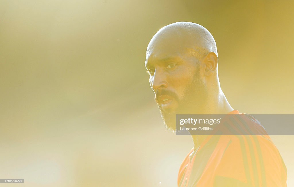 <a gi-track='captionPersonalityLinkClicked' href=/galleries/search?phrase=Nicolas+Anelka&family=editorial&specificpeople=206204 ng-click='$event.stopPropagation()'>Nicolas Anelka</a> of West Bromwich Albion looks on during a Pre Season Friendly between West Bromwich Albion and Genoa at the New Bucks Head Stadium on August 1, 2013 in Telford, England.