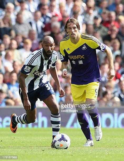 Nicolas Anelka of West Bromwich moves away from Miguel Michu during the Barclays Premier League match between West Bromwich Albion and Swansea City...