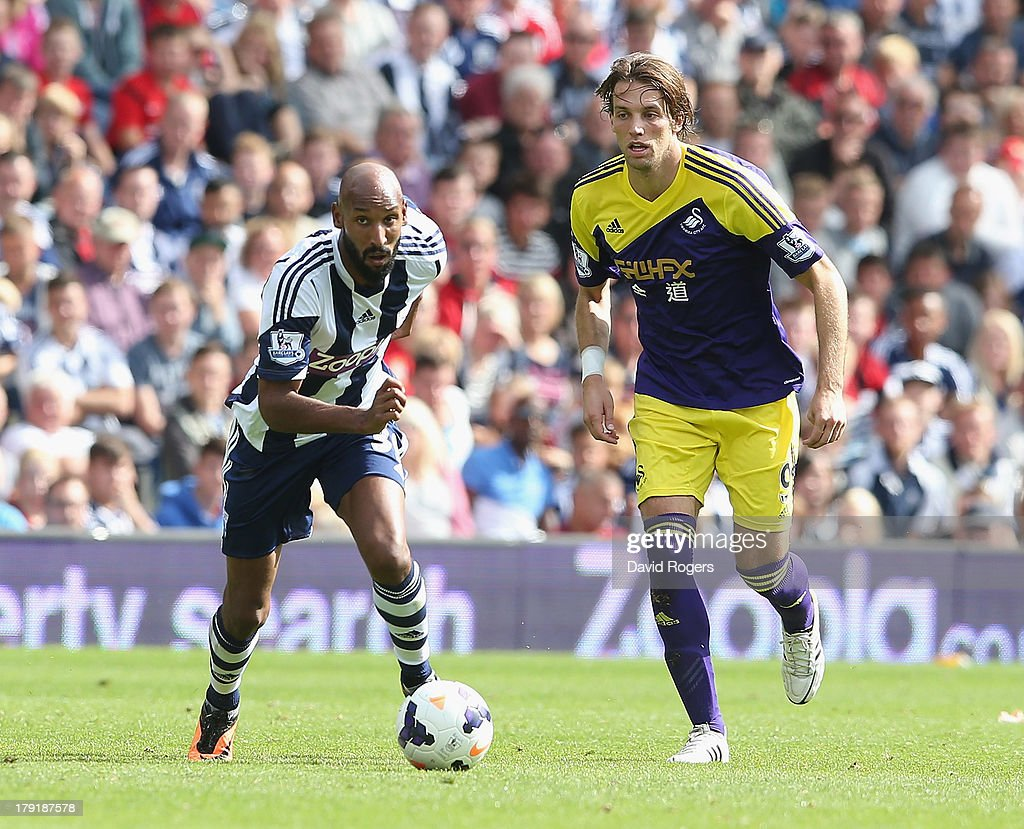<a gi-track='captionPersonalityLinkClicked' href=/galleries/search?phrase=Nicolas+Anelka&family=editorial&specificpeople=206204 ng-click='$event.stopPropagation()'>Nicolas Anelka</a> of West Bromwich moves away from Miguel <a gi-track='captionPersonalityLinkClicked' href=/galleries/search?phrase=Michu+-+Voetballer&family=editorial&specificpeople=9691137 ng-click='$event.stopPropagation()'>Michu</a> during the Barclays Premier League match between West Bromwich Albion and Swansea City at The Hawthorns on September 01, 2013 in West Bromwich, England.