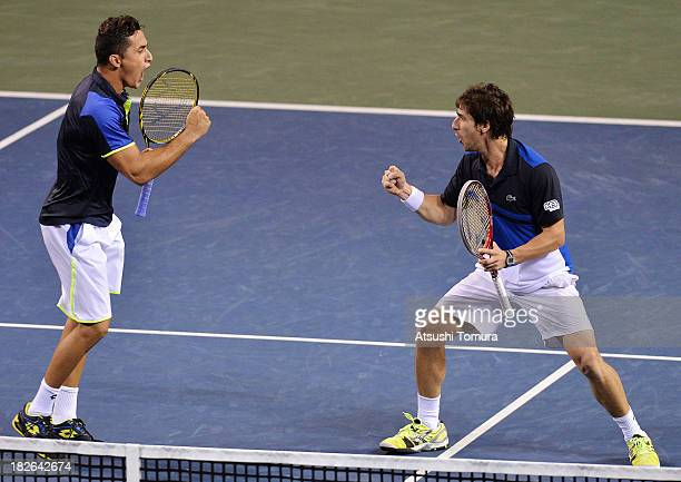 Nicolas Armagro of Spain and Pablo Cuevas of Uruguay celebrate after winning the men's first round doubles match against Bob Bryan of the United...