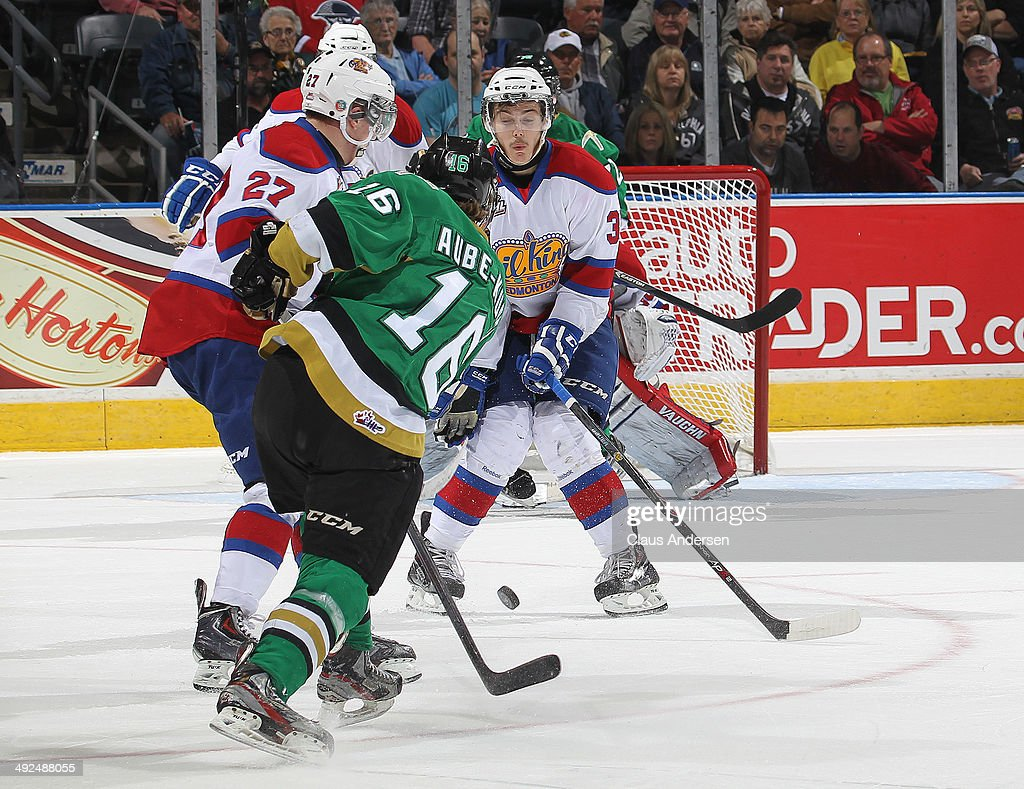Nicolas Aube-Kubel #16 of the Val'Dor Foreurs fires a shot that Dysin Mayo #37 of the Edmonton Oil Kings tries to block in Game Five of the 2014 MasterCard Memorial Cup at Budweiser Gardens on May 20, 2014 in London, Ontario, Canada.