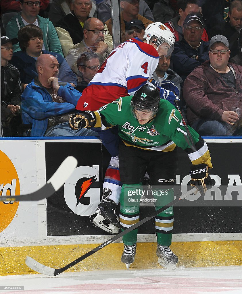 Nicolas Aube-Kubel #16 of the Val'Dor Foreurs takes Blake Orban #4 of the Edmonton Oil Kings into the boards in Game Five of the 2014 MasterCard Memorial Cup at Budweiser Gardens on May 20, 2014 in London, Ontario, Canada.