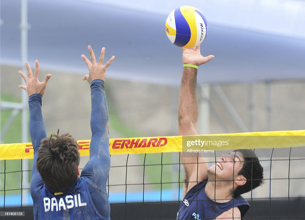 Nicolas Aveiro of Argentina spikes during the Men's Beach Volleyball Semi Final as part of the I ODESUR South American Youth Games at Parque Tematico de los Deportes on September 25, 2013 in Lima, Peru.