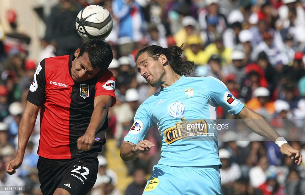 Nicolas Ayr (R) of Sporting Cristal fights for the ball with Manuel Contreras (L) of Melgar FC during a match between Sporting Cristal and Melgar FC as part of the Torneo Descentralizado 2013 at the Mariano Melgar Stadium on April 21, 2013 in Arequipa, Peru.