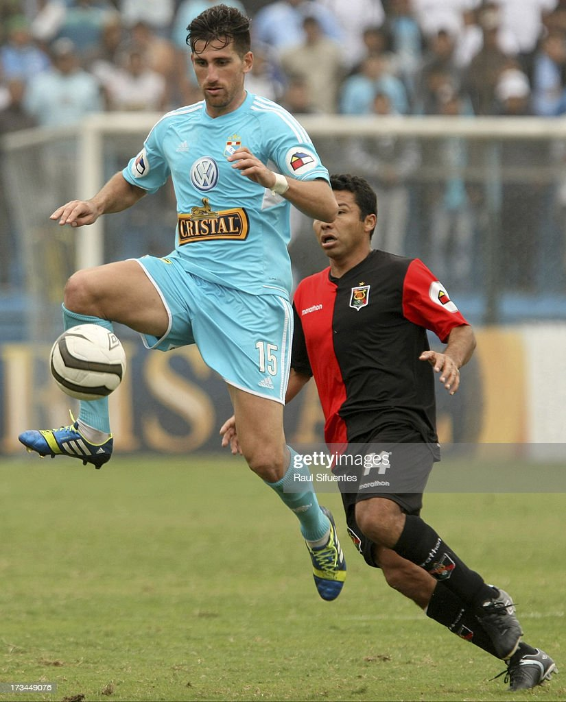 Nicolas Ayr (L) of Sporting Cristal fights for the ball with <a gi-track='captionPersonalityLinkClicked' href=/galleries/search?phrase=Ysrael+Zuniga&family=editorial&specificpeople=3473174 ng-click='$event.stopPropagation()'>Ysrael Zuniga</a> (R) of Melgar FC during a match between Sporting Cristal and Melgar FC as part of the Torneo Descentralizado 2013 at Alberto Gallardo Stadium on July 14, 2013 in Lima, Peru.
