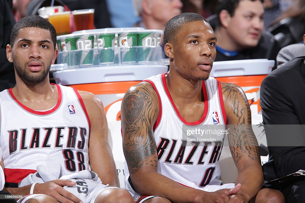Nicolas Batum #88 and Damian Lillard #0 of the Portland Trail Blazers sit on the bench during the game against the Cleveland Cavaliers on January 16, 2013 at the Rose Garden Arena in Portland, Oregon.